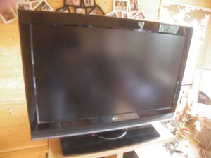 """a used 37"""" LG flat screen television with remote."""