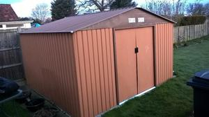 Garde Shed Metal 10 foot by 8 foot, less than 8 months old, including Base