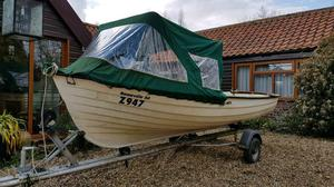 Rana open boat with cuddy and trailer