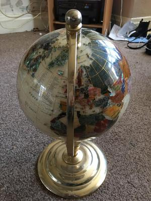 Vintage world globe with gem stones