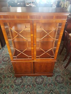 Yew display cabinet with key