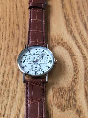 Ladies or gents watch with a genuine brown leather strap brand new