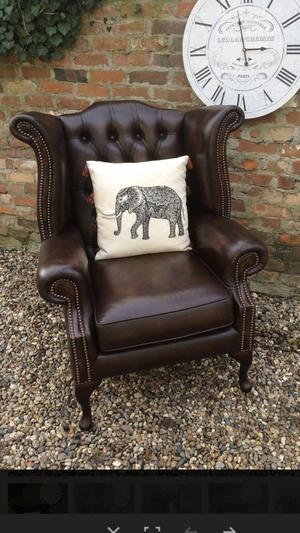 Wing back Queen Ann brown chesterfield armchair..