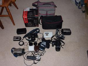 A Collection of Cameras and Equipment Including Minolta  and FinePix S