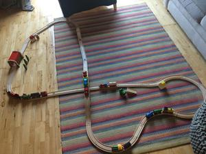 Bundle of wooden train track and trains