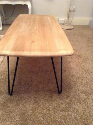 Industrial style coffee table with an oak top and metal legs
