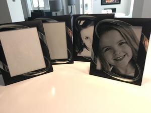 Four 10x8 black and silver photo frames