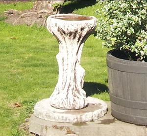 Stone bird bath with stone stand