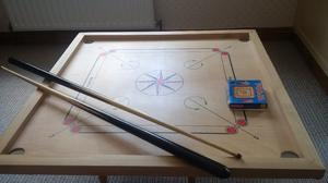 wooden board game called pooja