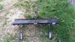Scarifier for a lawn tractor