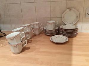 Tea cups and saucers and plates