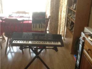 Yamaha electric keyboard, stand and books in Basingstoke