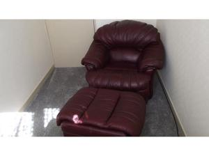 Leather armchair and footstool. in Ammanford