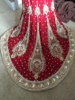 Beautiful elegant red and gold Asian bridal dress
