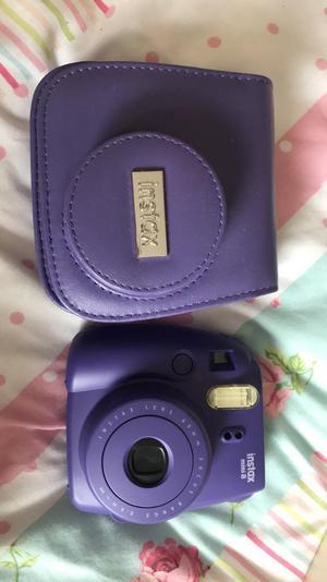 Purple instax mini disposable camera