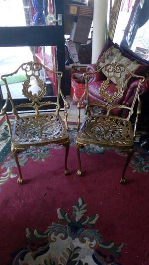 pair of Vintage ornate cast iron chairs