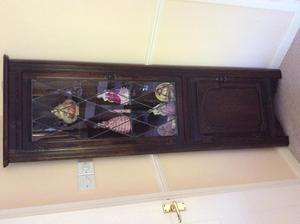 Oak display corner cabinet with light.