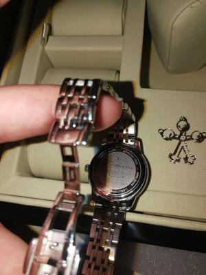 Have a box and certificate. Beautiful ladies watch with mother of pearl face and diamonds