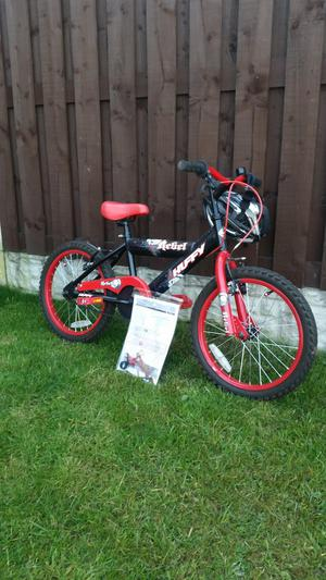 """Boys 18"""" bike like brand new with helmet can deliver"""