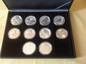 COLLECTION OF TEN 1 OZ SILVER COLLECTABLE COINS VARIOUS MINTS AND LIMITED EDITIONS