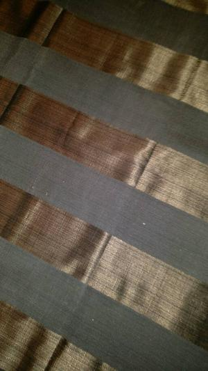 Roman blind with black and rust stripe