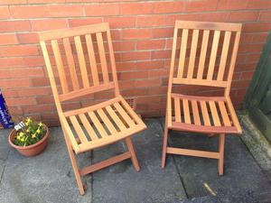 PAIR of new good quality hardwood garden chairs