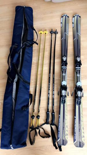 Atomic skis, 2 sets of poles and carry bag