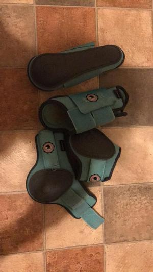 Mint green tendon and fetlock boots and numnah pony