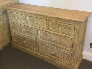 Oak bedroom suite. Chest of drawers and 2 bedside tables.
