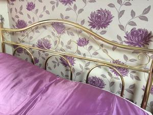 Bed base and gold effect headboard