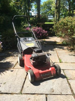 Rotary powered lawn mower