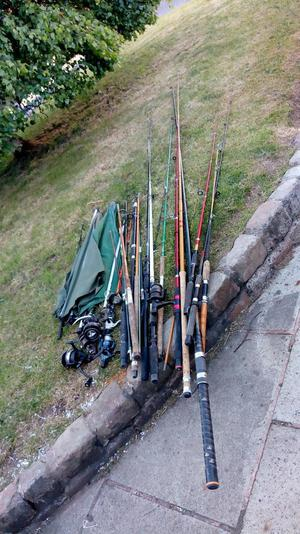 Large job lot of fishing rods plus reel and brollys