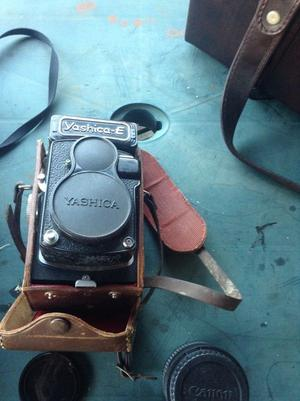 A large collection of vintage cameras and lenses