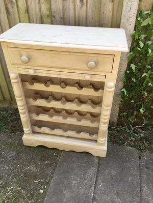 Wooden wine rack with drawer