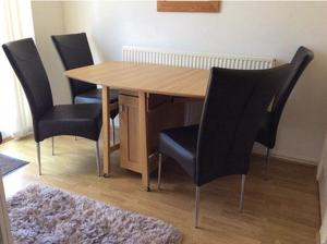 Dining table and chairs in Exeter