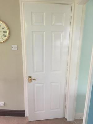 Over ten interior white wooden doors with handles and hinges