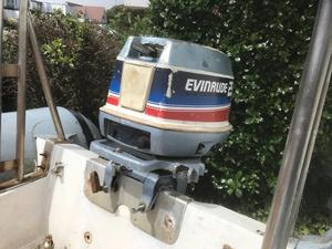 Rib boat with 25 HP evinrude and new jockey seat. Needs steering and remote cables.