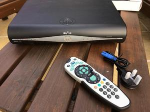 Sky + HD box with remote and power cable plus extras