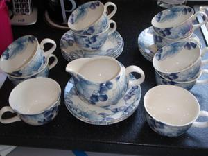 Cups and Saucers plus jug x 22 pieces
