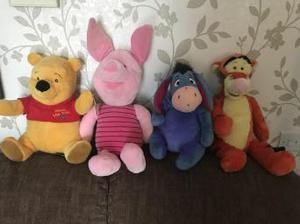 Set of Winnie the Pooh character soft toys.