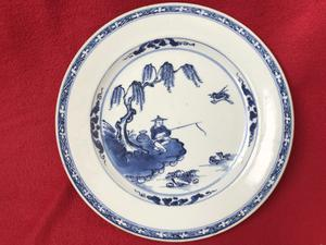 Blue and white plate decorated with a Chinese sinner - China