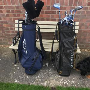 2 sets of golf clubs 1 ladies and 1 gentlemen's