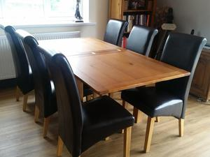 Harveys solid oak dining room table and 6 chairs
