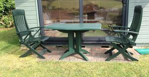 Pair of attractive Grossfillex dark green garden chairs.