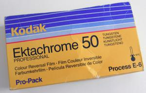 Vintage 9½ x 12 inches darkroom photo paper and two rolls of 120 film