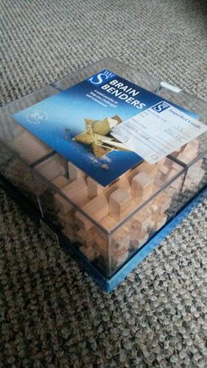 brain benders 4 wooden puzzles