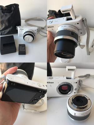 Nikon 1 J1 digital camera with mm lens J2