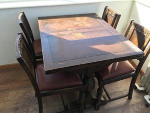 Expanding wooden dining table and five chairs