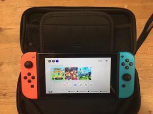 Nintendo Switch + Mario kart 8, Zelda, Pokemon Quest