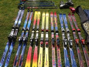 8 sets of skis in various sizes